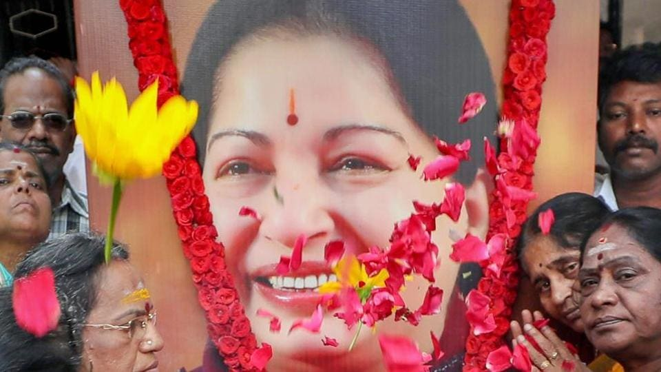 AIADMK members pay floral tribute to former Tamil Nadu Chief Minister J Jayalalithaa on her 70th birth anniversary in Coimbatore.