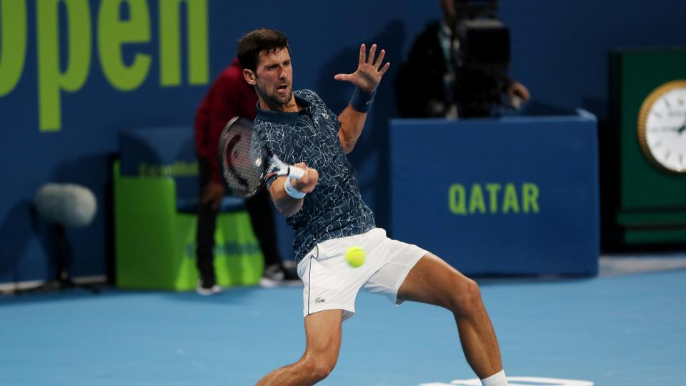 Serbia's Novak Djokovic in action during his first round match against Bosnia and Herzegovina's Damir Dzumhur in Qatar.