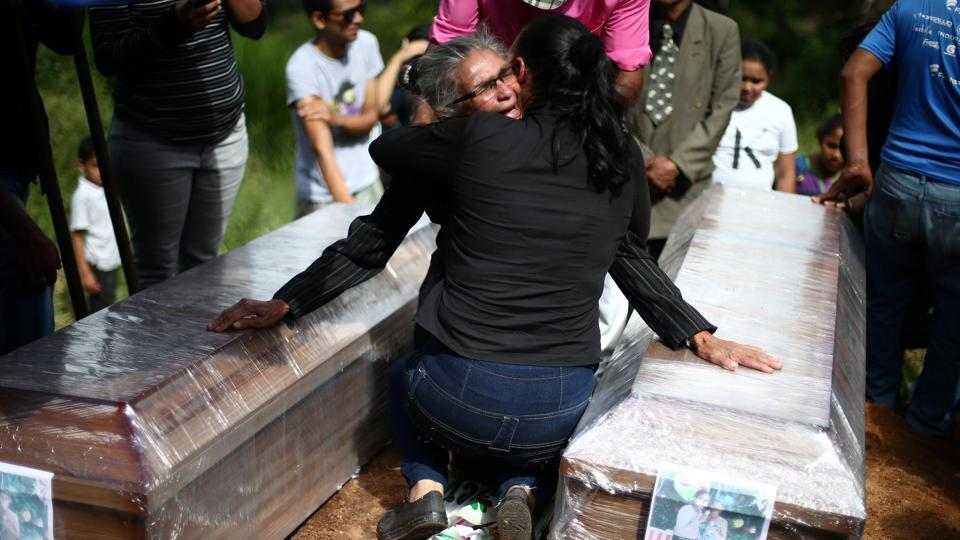 During his roughly three months spent in Honduras in 2018, Garrido photographed mothers waiting at the morgue for the bodies of murdered sons and daughters, police keeping watch over corpses left lying on streets after shootouts and families wailing over the coffins of loved ones. (Edgard Garrido / REUTERS)