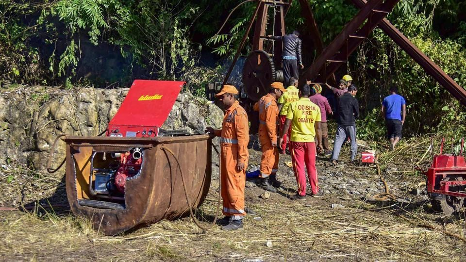Odisha Fire and Disaster team pumping the water from nearby old shaft located 500 meters from the main site of a coal mine that collapsed in Ksan, in Meghalaya.
