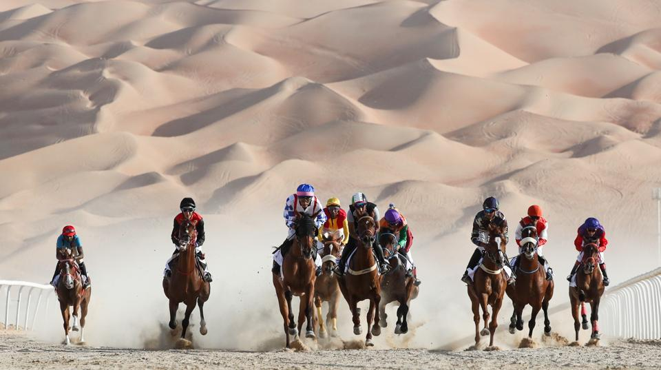 Jockeys compete in a race for purebred Arab horses in the Liwa desert, some 250 kilometres west of Abu Dhabi, United Arab Emirates during the Liwa 2019 Moreeb Dune Festival on January 1, 2019. The festival, which attracts participants from around the Gulf region, hosts a variety of races and activities aimed at promoting the country's folklore. (Karim Sahib / AFP)