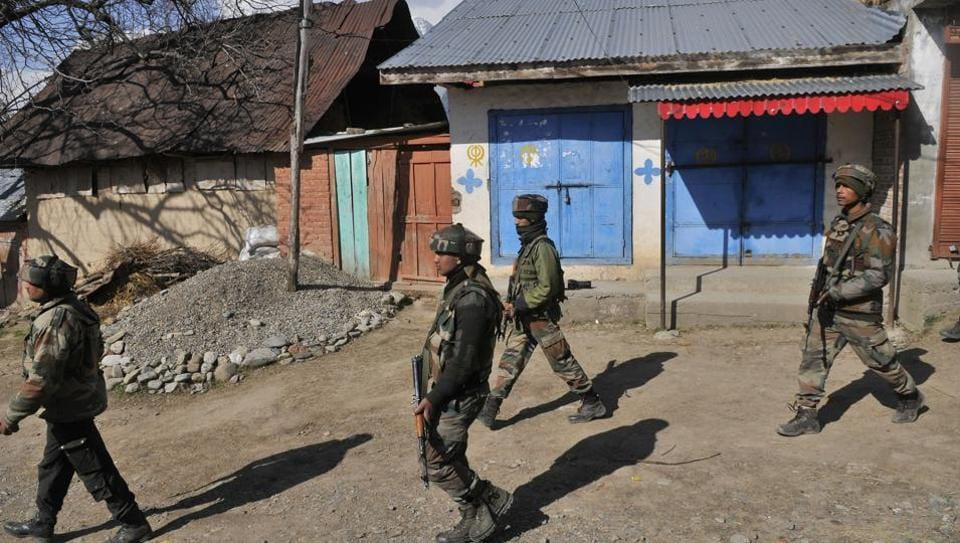 Army soldiers walks near the site of encounter in south Kashmir's Tral area some 45 kms from Srinagar.