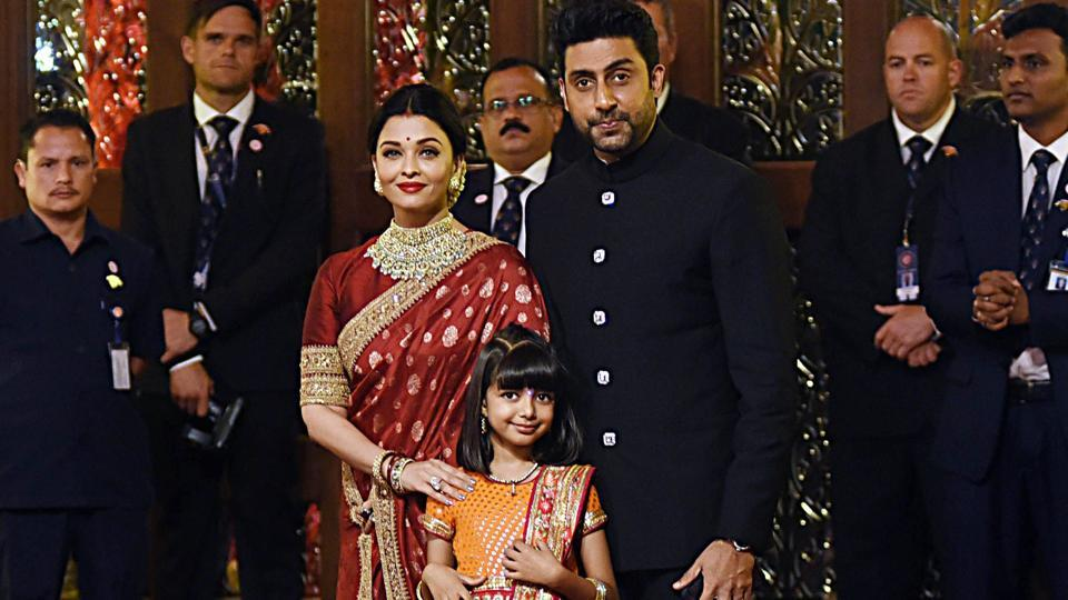 Aishwarya Rai Bachchan and Abhishek Bachchan with daughter Aaradhya pose for a picture as they attend the wedding ceremony of Isha Ambani.