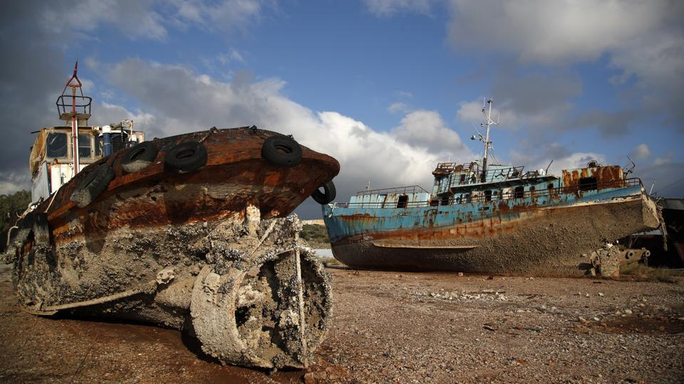 "Now Greek authorities have begun to remove the ships, some of which have been there for decades, saying they are both an environmental hazard and a danger to modern shipping. ""We are speaking about 27 shipwrecks and potentially ... 12 harmful and dangerous ships,"" said Charalampos Gargaretas, the chief executive officer of Elefsina Port Authority. ""(It's) a tragic situation."" (Thanassis Stavrakis / AP)"