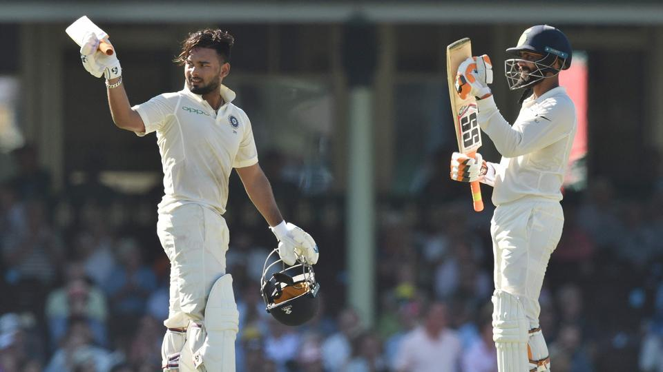 India batsman Rishabh Pant (L) celebrates his 150 runs with teammate Ravindra Jadeja (R) on the second day of the fourth and final cricket Test against Australia at the Sydney Cricket Ground in Sydney