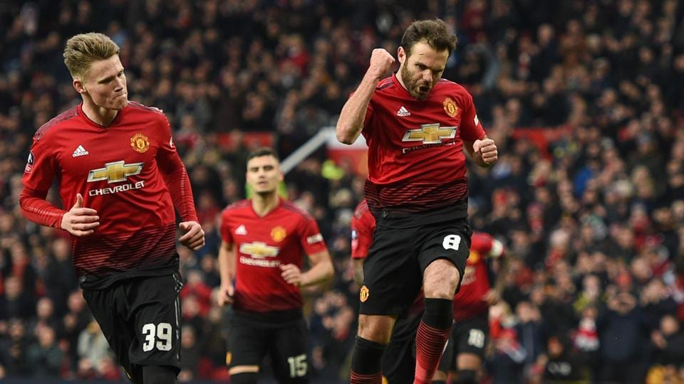Manchester United's Spanish midfielder Juan Mata (C) celebrates scoring the opening goal during the English FA Cup third round football match between Manchester United and Reading at Old Trafford.