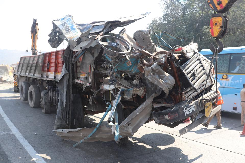 In a major e-way accident four people, including three from Pune, died while five others suffered injuries after a truck loaded with cement bags fell on three other cars.