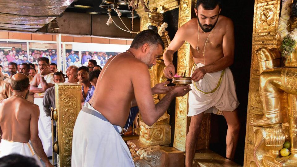 Priests carry out 'purification' of the Lord Ayyappa Temple after two women in their early 40s entered the shrine and offered prayers, in Sabarimala, Kerala. (PTI)