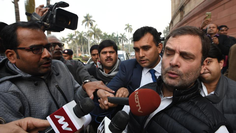 Congress President Rahul Gandhi is mobbed by member s of the media as he leaves after attending a day's worth of heated proceedings over the Rafale deal during the Parliament's Winter Session in New Delhi. (Sonu Mehta / HT Photo)