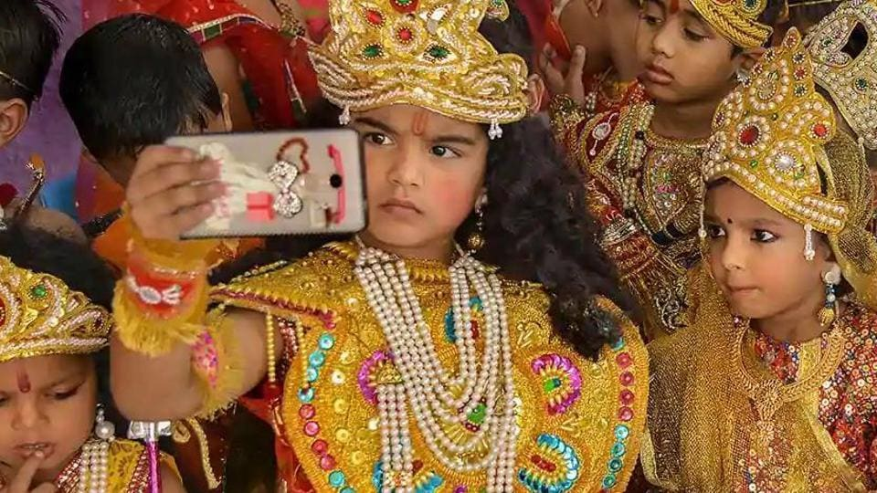 Children dressed as Lord Ram and Sita take a selfie during 'Diwali' celebrations in Ajmer.
