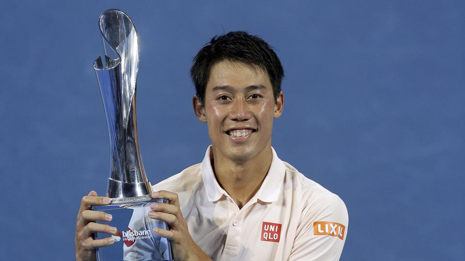 Kei Nishikori of Japan poses with the trophy.