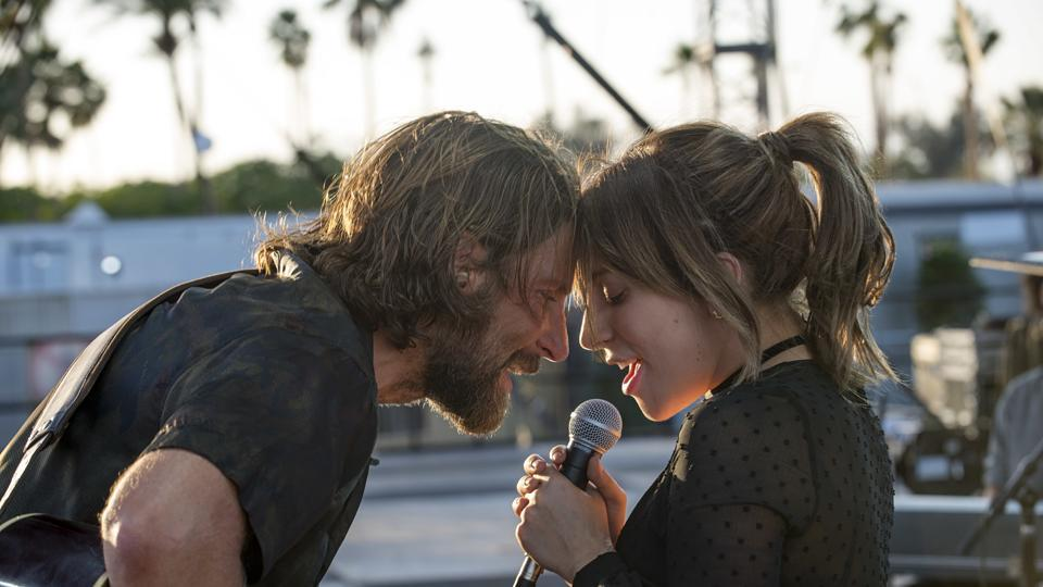 This image released by Warner Bros. shows Bradley Cooper, left, and Lady Gaga in a scene from the latest reboot of the film, A Star is Born.