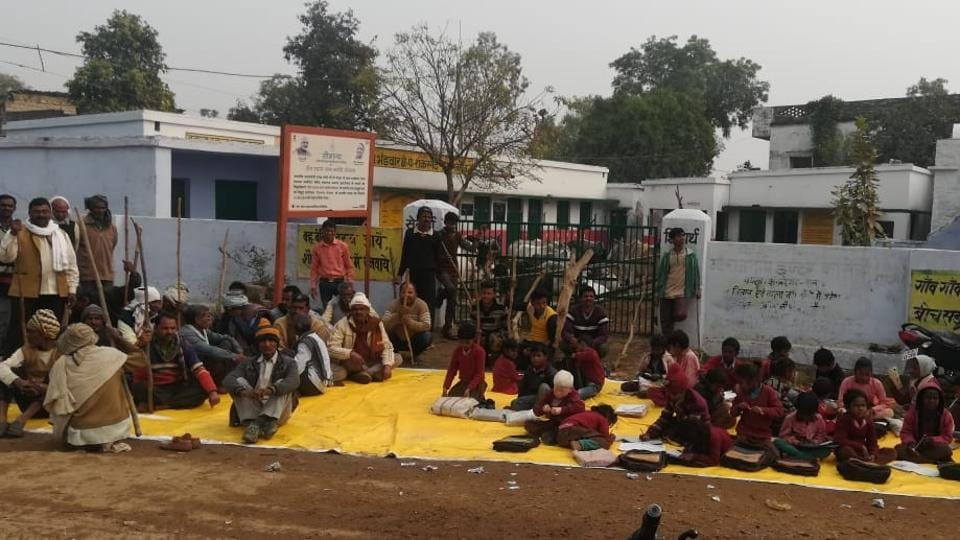 Students of a primary school in Bhadivar village of UP's Prayagraj district study in the chill outside as farmers lock up stray cattle in the school premises