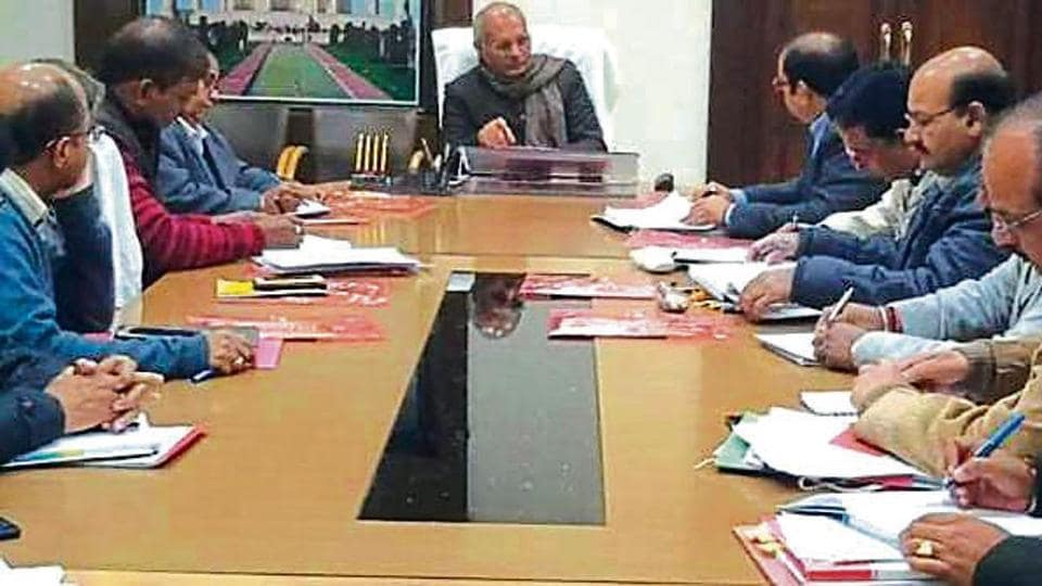 UP irrigation minister Dharam Pal Singh in a meeting with irrigation department officials in Agra on Sunday.