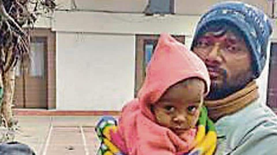 The nine-month-old boy with his parents. His parents said he had been abducted from a pavement in central Delhi.