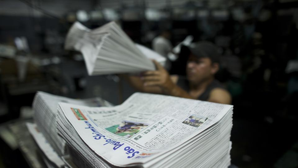 A recent edition of the Sao Paulo Shimbun is stacked into piles before delivery in Sao Paulo, Brazil. For decades this newspaper, from its offices in Sao Paulo's Asian neighbourhood of Liberdade, served as the main reference point for Japanese living in the South American country. While mainly in Japanese, it printed a few pages in Portuguese as well. January 01 marked the end of a 72-year run. (Victor R. Caivano / AP)