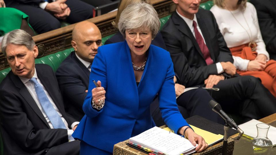 A handout photograph released by the UK Parliament shows Britain's Prime Minister Theresa May attending the weekly Prime Minister's Questions (PMQs) in the House of Commons in London on December 19, 2018 (File Photo)