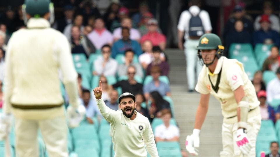 India skipper Virat Kohli celebrates the fall of a Australia wicket in Sydney.
