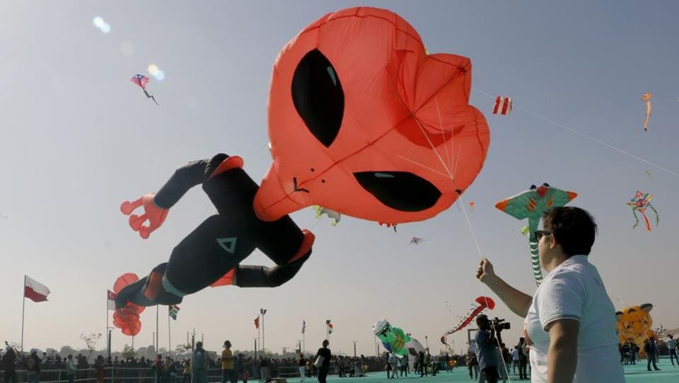 Kite flyers from across the country and abroad are participating in the 30th iteration of the international kite festival that kicked off in Ahmedabad, Gujarat on Sunday. Uttarayan, the kite festival is held annually on the city's Sabarmati riverfront. (Siddharaj Solanki / HT Photo)