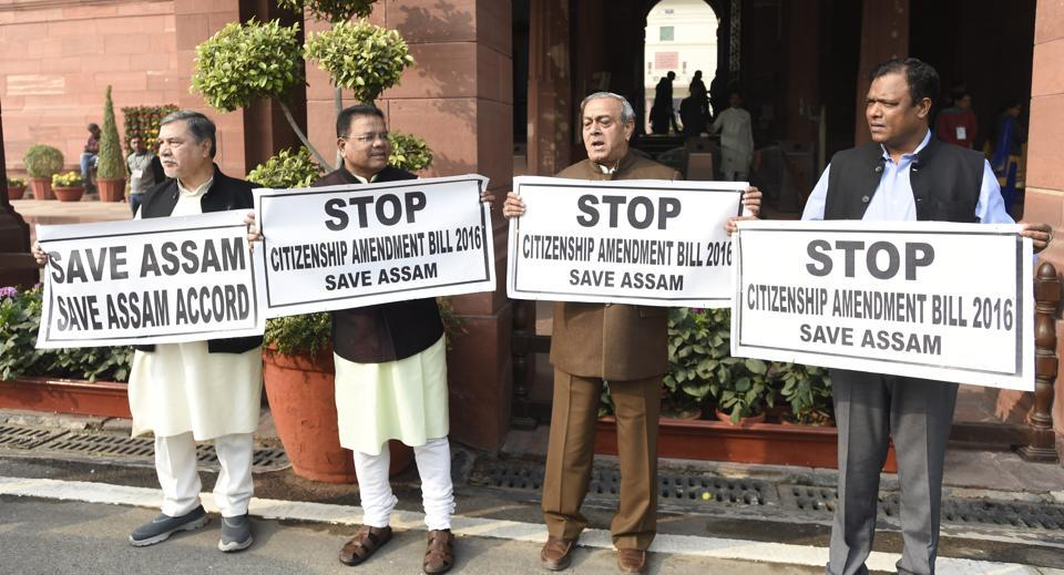 Congress MPs hold placards during a protest demanding to stop Citizenship Amendment Bill 2016, during the Winter Session of Parliament, in New Delhi on January 7.