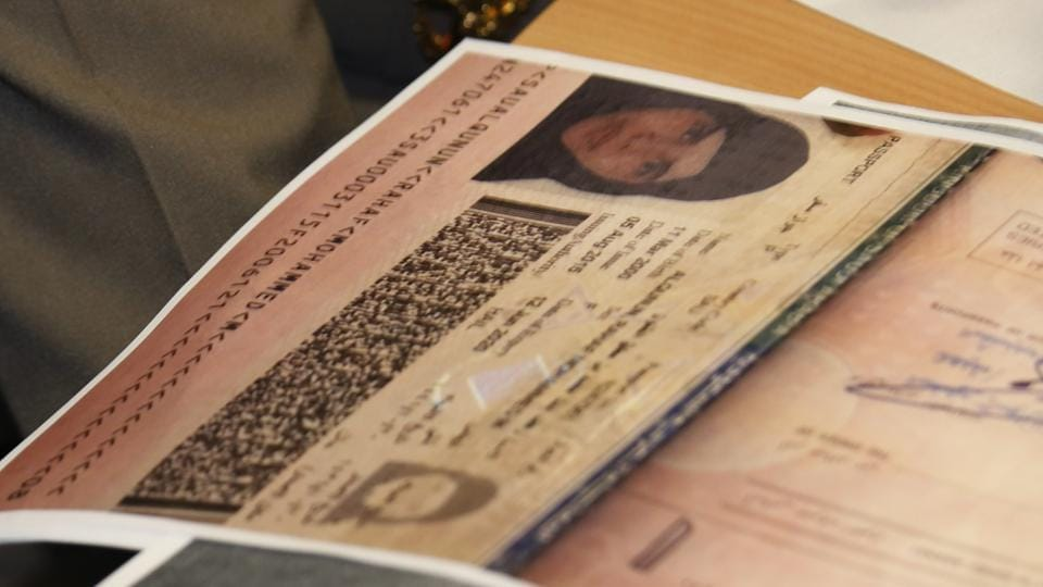 A passport copy of Rahaf Mohammed Alqunun sits on the desk as Chief of Immigration Police Maj. Gen. Surachate Hakparn talks to media about her status during a press conference at the Suvarnabhumi Airport in Bangkok on January 7.