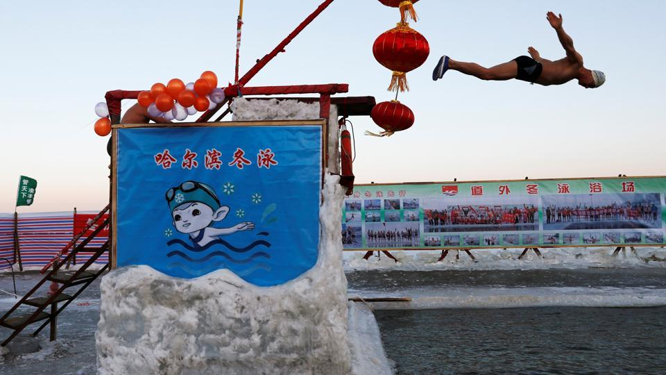 """You have to start swimming from autumn so that the body can conquer the sudden icy impact on one's cardio-vascular system,"" said Yu. ""The feeling of diving into the water is very cool."" More than 300 men and women, wearing just ordinary trunks and swimsuits, on Saturday braved the bitter cold waters at Harbin's annual winter festival, among the biggest in the northern hemisphere. (Tyrone Siu / REUTERS)"