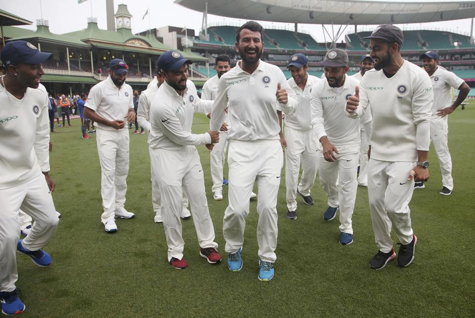 India's Virhat Kohli, right, encourages Cheteshwar Pujara, center, as the team dance as they celebrate their series win over Australia after play was called off on day 5 of their cricket test match in Sydney, Monday, Jan. 7, 2019. The match is a draw and India wins the series 2-1. (AP Photo/Rick Rycroft) (AP)