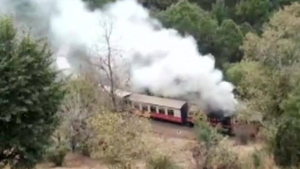 The engine of a Shimla-bound Himalayan Queen toy train caught fire between Himachal Pradesh's Dharampur and Koti railway stations Tuesday afternoon, railway officials said.