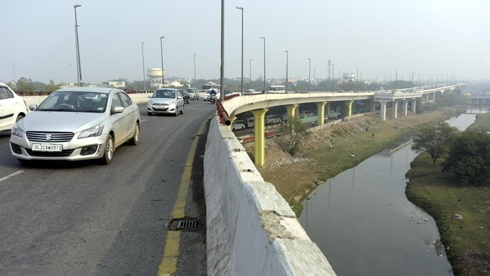 The woman died after falling almost 70 feet from the Barapullah elevated corridor (in pic) into the drain flowing below while her husband sustained multiple injuries.