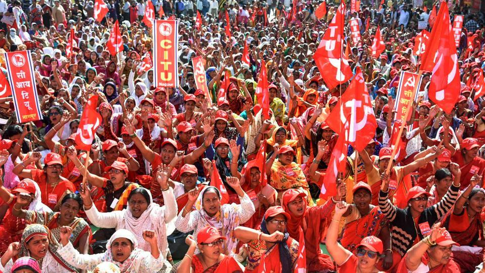 Activists under the banner of Centre of Indian Trade Unions (CITU) raise slogans during the 48-hours-long nationwide general strike called by central trade unions protesting against