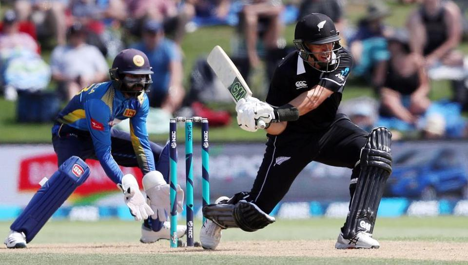 Ross Taylor (R) bats while he is watched by Sri Lanka's Niroshan Dickwella.