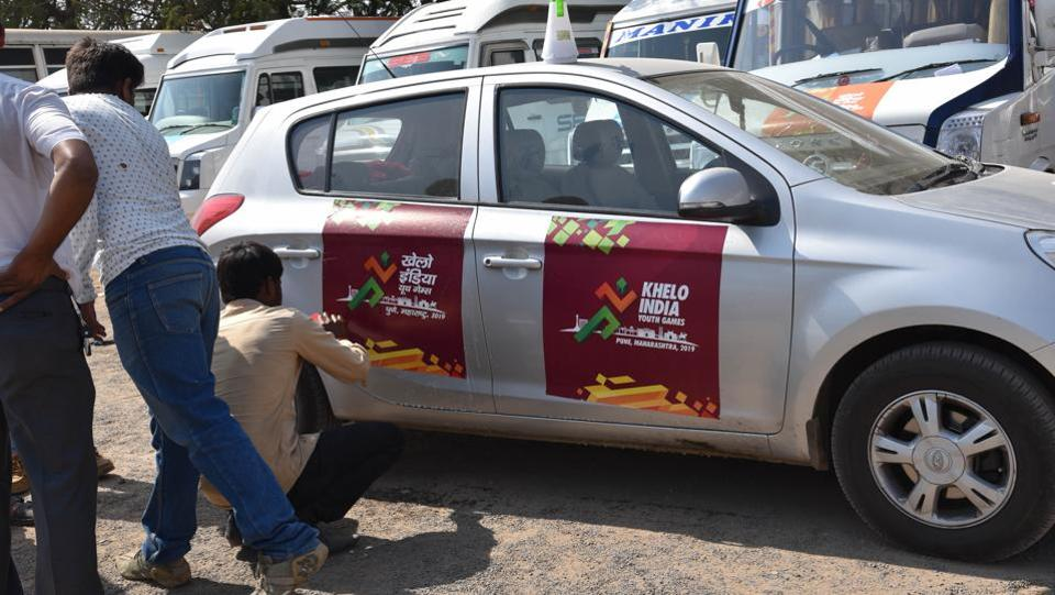 Cars and buses are branded with Khelo India logo ahead of the opening ceremony. (HT PHOTO)