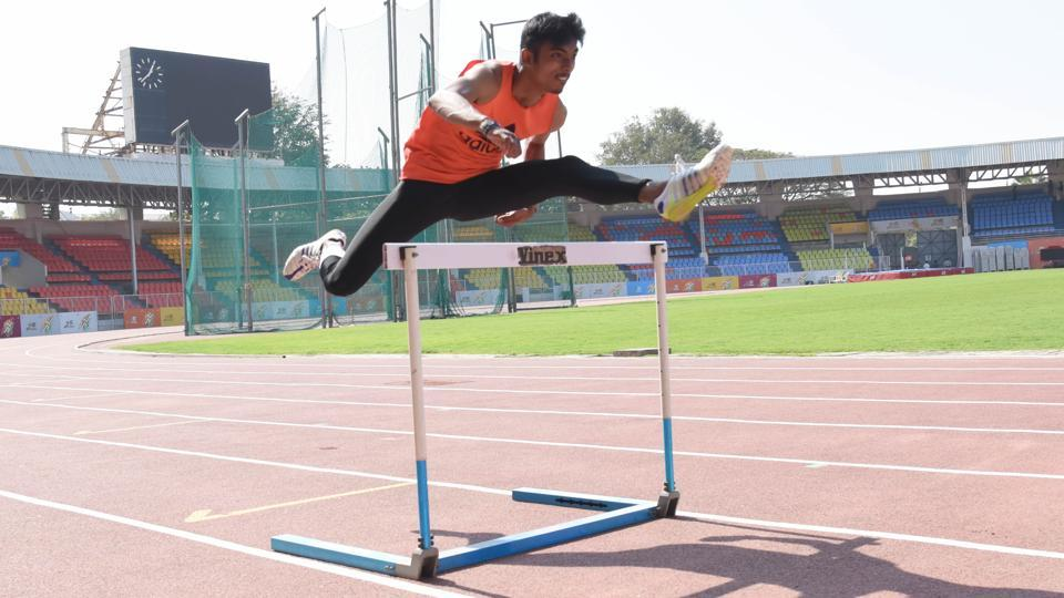 Khelo India Youth Games, Maharashtra 2019 will see 12,500 participants, both teams and individuals, from 29 states and seven union territories. Tejas Shirshe of Maharashtra during a practice session at Shree Shiv Chhatrapati Sports Complex. Tejas who is from Aurangabad will take part in under-17 event of 110 metres hurdles race. (HT PHOTO)