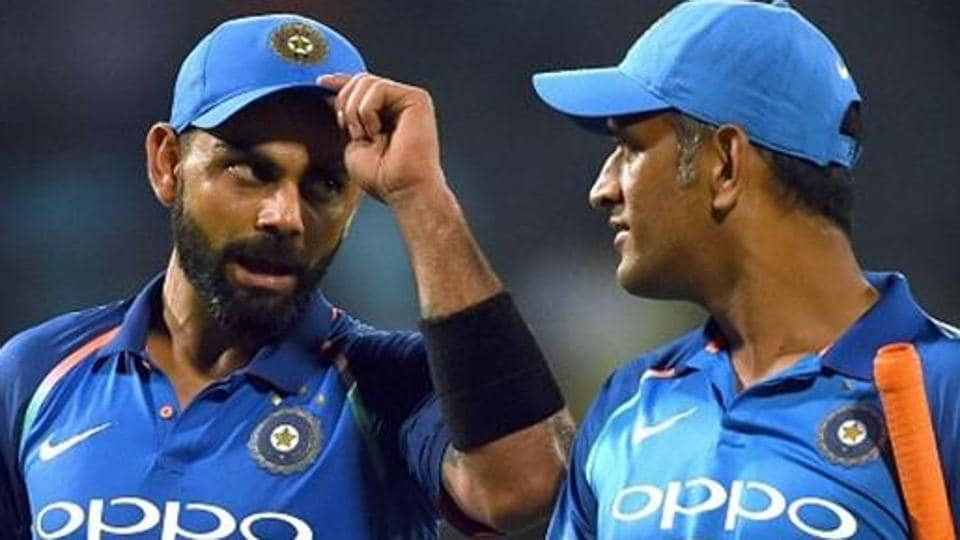 Indian cricket captain Virat Kohli (L) celebrates with teammate Mahendra Singh Dhoni (R) after victory in the final one day international (ODI) cricket match between Sri Lanka and India at The R. Premadasa Stadium in Colombo on September 3, 2017.