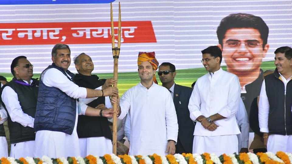 "Congress President Rahul Gandhi is presented a memento during a farmers' rally at Vidyadhar Nagar ground, in Jaipur. Gandhi criticised Prime Minister Narendra Modi for not doing enough for the farmers. ""The PM always plays on the back foot, I want the youth of the country to play of front foot and hit a sixer,"" he said during the rally. (PTI)"