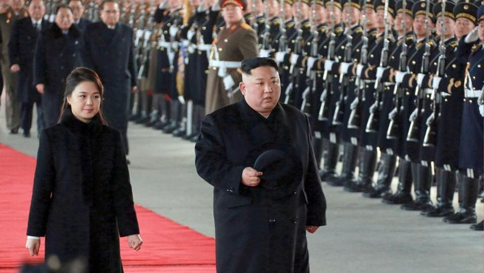 In this Monday, Jan. 7, 2019, photo provided on Tuesday, Jan. 8, 2019, by the North Korean government, North Korean leader Kim Jong Un walks with his wife Ri Sol Ju at Pyongyang Station in Pyongyang, North Korea, before leaving for China. Kim met Xi Jinping in Beijing onWednesday but no details of their meeting were disclosed by Chinese state media. (Korean Central News Agency/Korea News Service via AP)