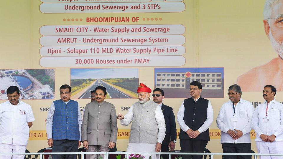 Prime Minister Narendra Modi inaugurates the Solapur-Tuljapur-Osmanabad section of New NH-52, in Solapur, Maharashtra. Modi also laid the foundation stone of an over Rs 1,800 crore project of 30,000 houses under Pradhan Mantri Awas Yojana there. (PTI)
