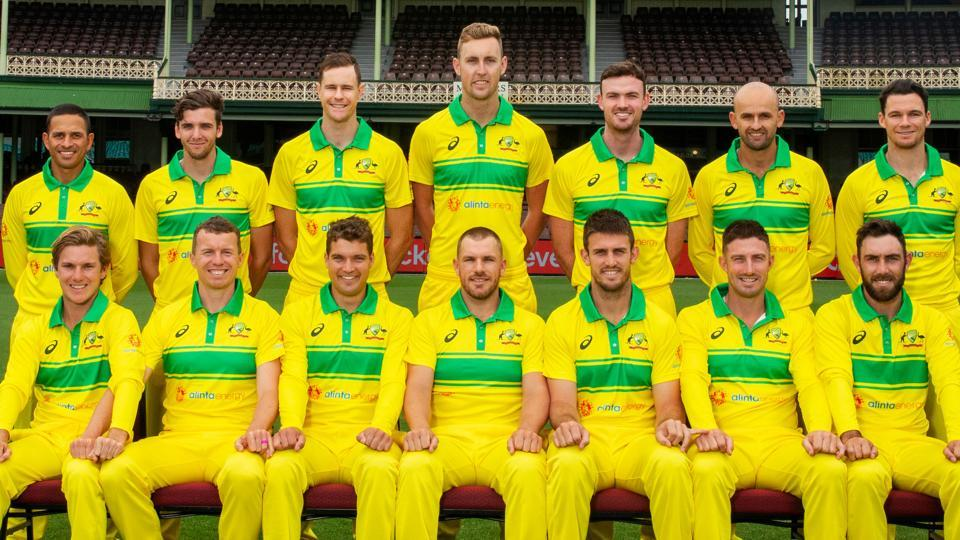 Australian players pose with their new jerseys.