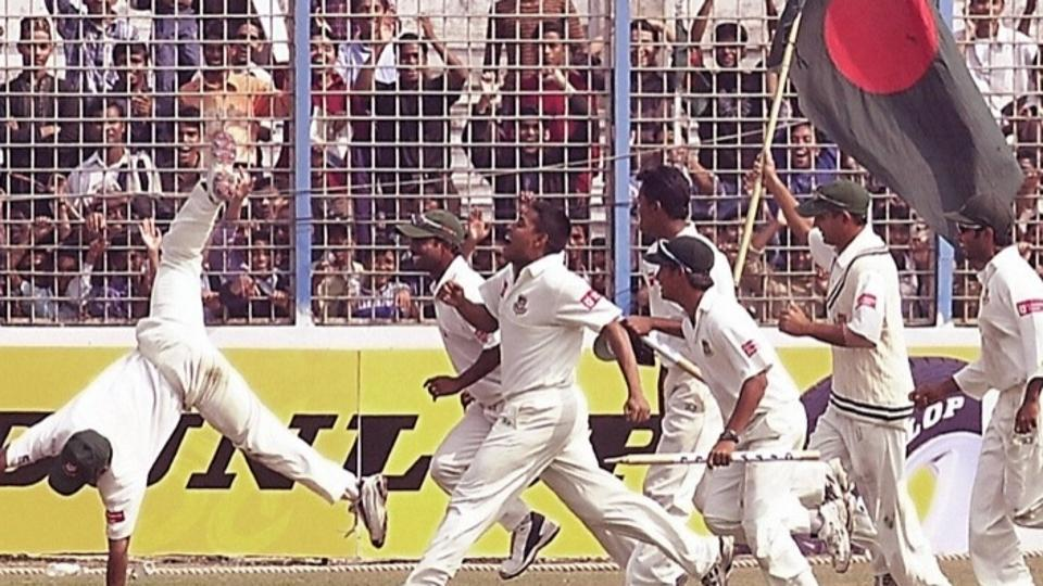 Bangladesh players celebrate after winning their first match in Test cricket.