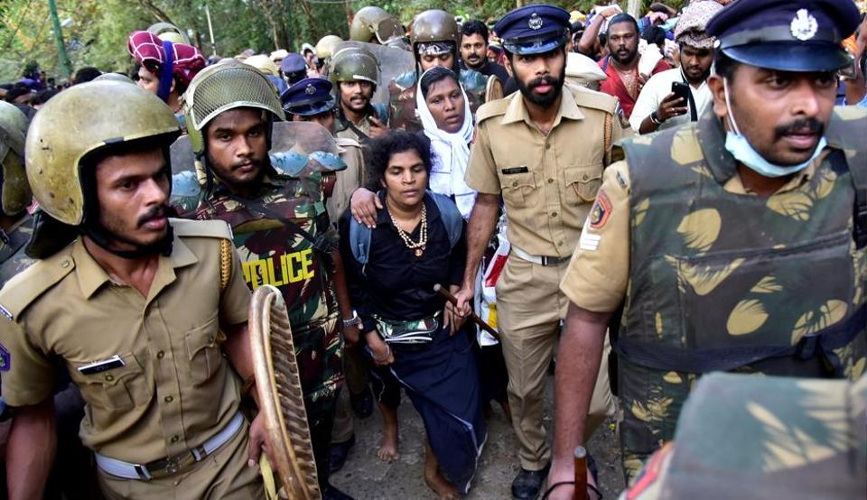 Bindu Ammini, 42, and Kanaka Durga, 44, are escorted by police after they attempted to enter the Sabarimala temple in Pathanamthitta district in Kerala on December 24.