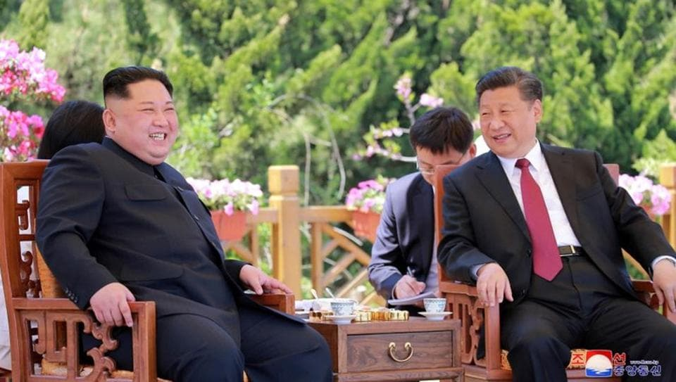 North Korean leader Kim Jong-un meets Chinese President Xi Jinping, in Dalian, China.