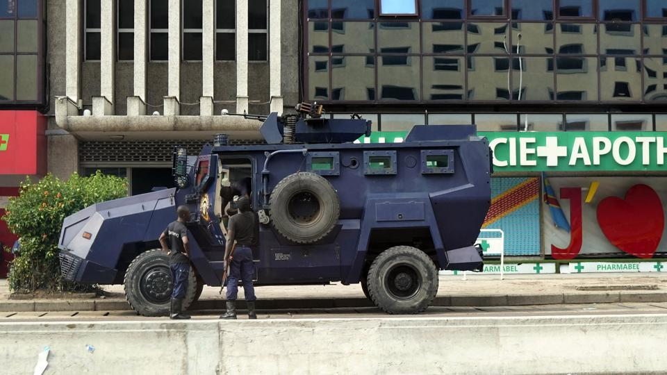 Congolese riot police takes position near the electoral commission building in Kinshasa, Congo, Wednesday Jan. 9.