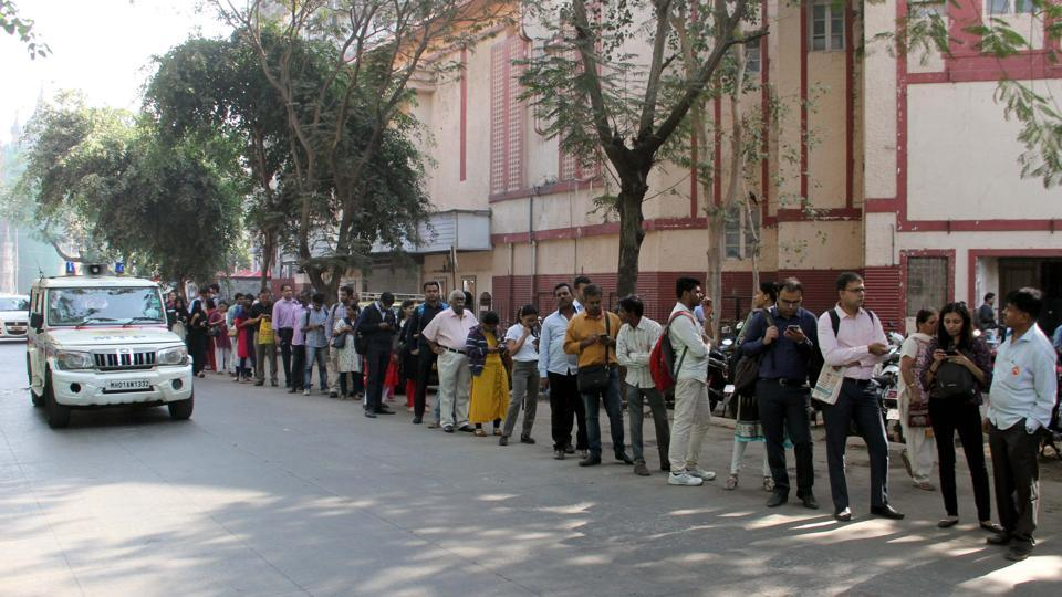 People stand in queue as they wait for taxis at Chhattrapati Maharaj Shivaji Terminus on 2nd day of the indefinite strike by BEST employees, in Mumbai, on Wednesday, 9 Jan, 2019.
