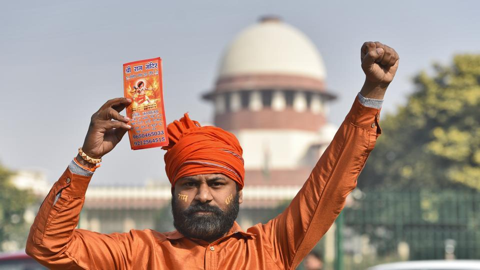 A Hindu group member protests to demand the construction of the Ram Temple, near Supreme Court in Delhi. Justice UU Lalit, one of the five judges of the Supreme Court constitution bench hearing the Ayodhya case, offered to opt out after a lawyer pointed out that he had represented one of the parties nearly two decades ago. The Supreme Court will now hear the case on January 29. (Burhaan Kinu / HT Photo)