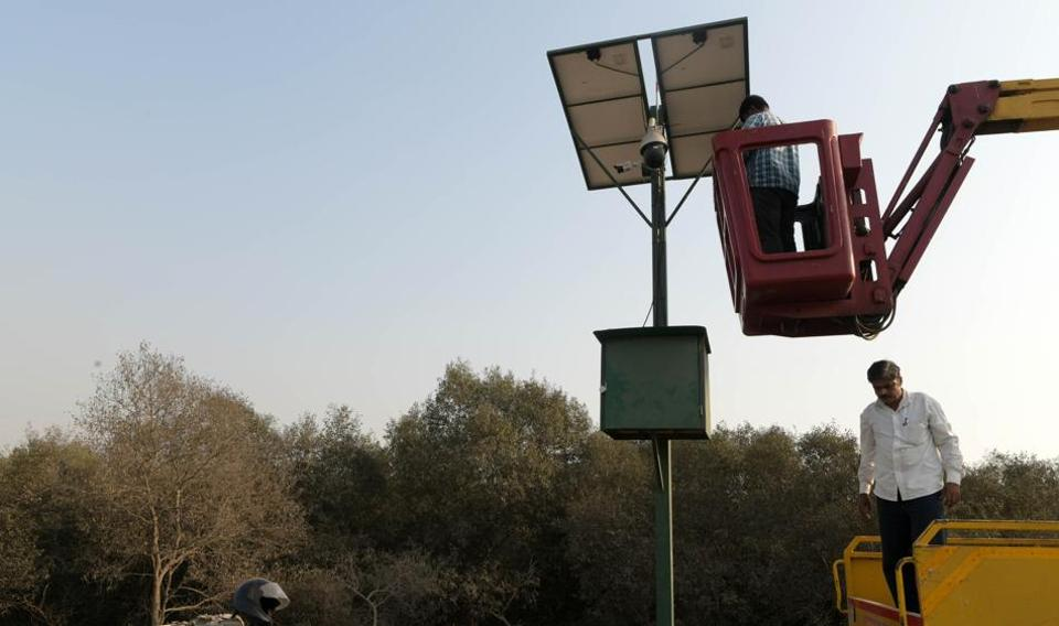 Officials check CCTVcameras installed near mangroves in Vashi along the Sion-Panvel Highway on experimental-basis.