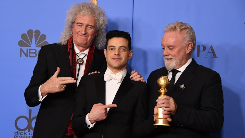 "Best Actor in a Motion Picture – Drama for ""Bohemian Rhapsody"" winner Rami Malek poses with Queen band members Roger Taylor (R) and Brian May (L) during the 76th annual Golden Globe Awards, at the Beverly Hilton hotel in Beverly Hills, California. (Mark Ralston / AFP)"