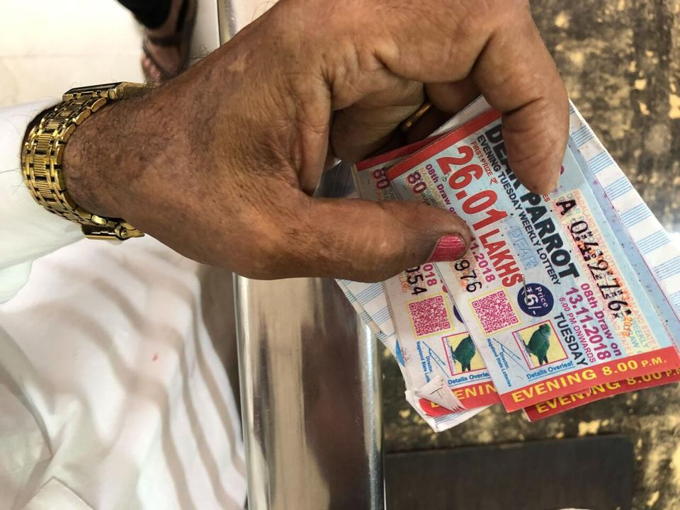 A buyer holding a Tuesday evening lottery ticket in Bara Bazaar, Kolkata.