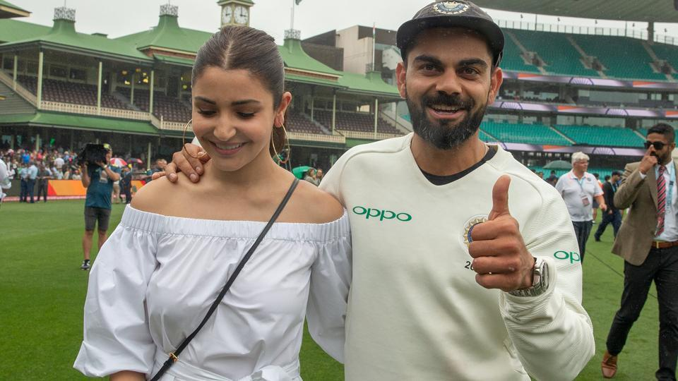 India's captain Virat Kohli celebrates with his wife Anushka Sharma after winning the series 2-1 following play being abandoned on day five in the fourth test match between Australia and India at the SCG in Sydney, Australia, January 7, 2019.