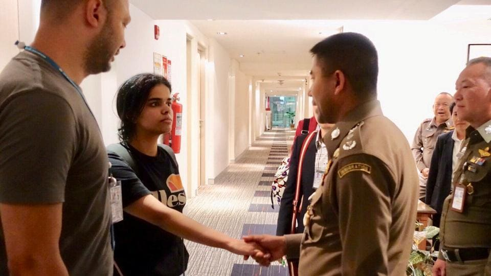Saudi teen Rahaf Mohammed al-Qunun is greeted by Thai immigration authorities and UNHCR officials at a hotel inside Suvarnabhumi Airport in Bangkok, Thailand. (Thailand Immigration Police via REUTERS )