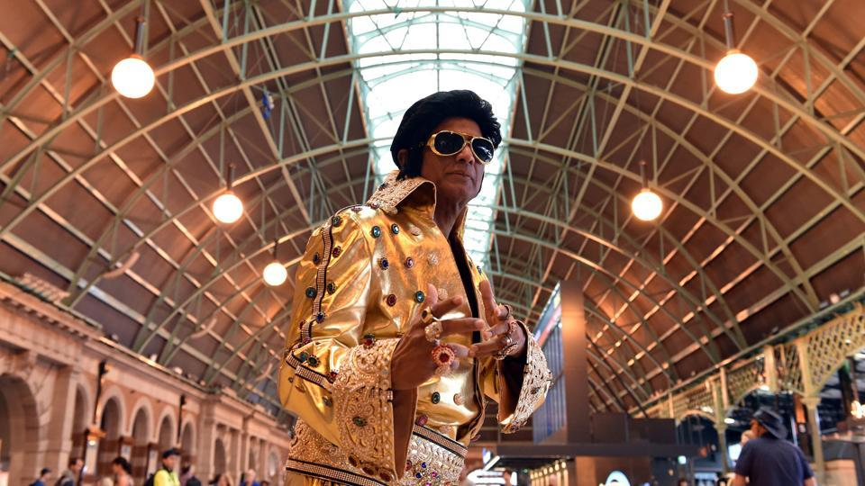 Elvis impersonator Alfre Vaz poses at Central Station in Sydney, Australia. Dressed in colourful sequined jumpsuits, suede shoes and having used copious amounts of hairspray, hundreds of Elvis lookalikes swarmed Sydney's Central Station on Thursday singing and dancing to hits belted out by tribute artists. (Mick Tsikas / AAP via REUTERS)